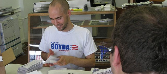 Jonathan Simon, a Kansas University junior from Lenexa, volunteers with the campaign of U.S. Rep. Nancy Boyda, D-Kan. Simon is among the KU students who are taking advantage of election year to get hands-on experience on a political campaign.