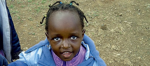A Kenyan girl arrives to be treated at a clinic in Maai Mahiu.