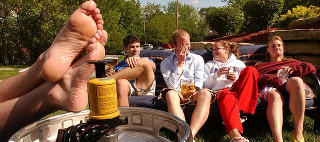 In this May 2006 file photo, Kansas University students unwind with a keg of beer on the lawn of the Hawk's Pointe 3 apartments. Student behavior is still a concern cited by neighborhood leaders with properties near campus.