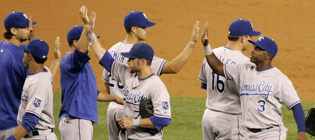 Kansas City Royals players Esteban German (3), Ross Gload (7), and Tony Pena Jr., left, celebrate with teammates after the ninth inning against the Yankees. The Royals defeated the Yankees, 4-3, on Friday in New York.