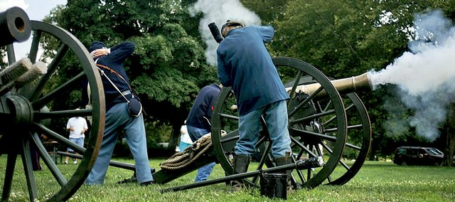 Sons of Union Veterans of the Civil War fire an 1859 6-pound field gun replica Saturday during a Civil War re-enactment at South Park. They fired the cannon with 10 ounces of black powder. Members of the Battery B, 3rd Kansas Frontier Brigade, headed the encampment.