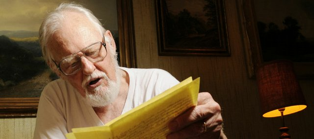 Daniel Merriam, Lawrence, a retired geologist from the Kansas Geological Survey, reads Wednesday from the letter he mailed to his wife, Annie, about the Warsaw Pact invasion 40 years ago when the Soviet Union and its allies invaded Czechoslovakia. He was in Prague, Czechoslovakia, on that day.