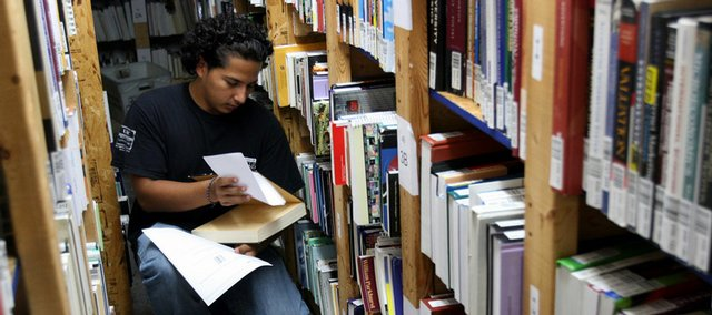 Jose Centeno, 19, of Hyattsville, Md., fills orders at Bookholders.com of College Park, Md., which sells used textbooks. The rising cost of college texts has driven Congress and several states to attempt to curtail prices and controversial publishing practices through legislation.