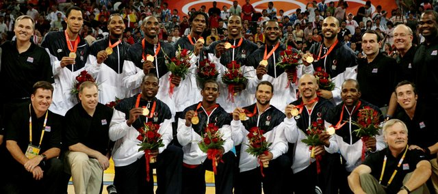 The United States basketball team gathers for a photo with its Olympic gold medals. The Americans beat Spain, 118-107, in the title game Sunday in Beijing.