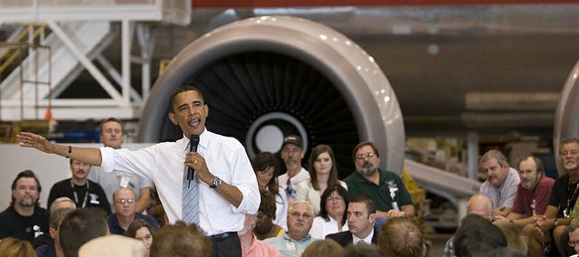 Democratic presidential candidate Barack Obama talks with American Airlines workers Tuesday inside the airliner's Kansas City, Mo., overhaul base.