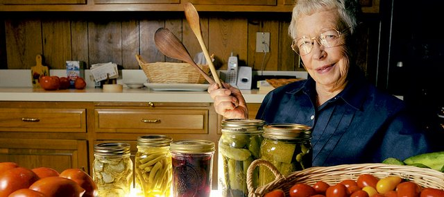 Irene Hain has been canning since she was old enough to hold a wooden spoon. Hain strains tomatoes through her grandmother's colander and cooks them in a water bath on a small stove her husband built for her in the garage. Canning is an effective and money-saving way to make summer produce last into the cooler-weather months.