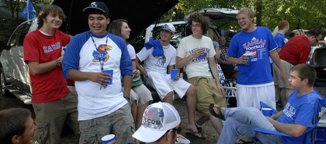 Tailgaters from kansas university await the start of the KU-Southeast Louisiana game in a yard north of Memorial Stadium along Alabama Street in this September 2007 file photo. Big 12 Conference football fans have had to wait eight months for the start of the 2008 season. KU will face Florida International on Saturday in a game that the Jayhawks - on paper - should dominate.