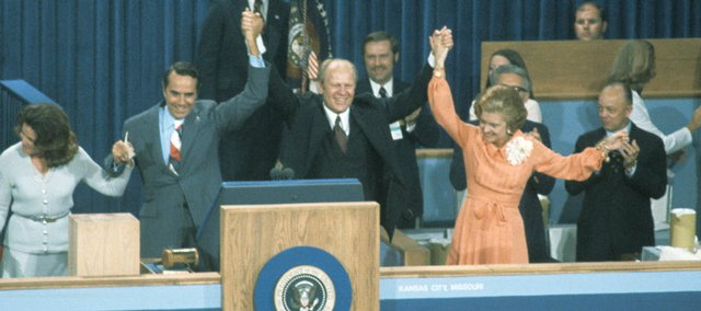 From left, Elizabeth and Bob Dole along with Gerald Ford and his wife, Betty, greet the massive crowd at Kemper Arena in 1976. The photo was taken during the Republican National Convention that year.