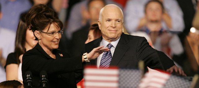 Republican presidential candidate Sen. John McCain, R-Ariz., and Republican Alaska Gov. Sarah Palin greet the crowd as McCain introduces Palin as his vice presidential running mate Friday at the Ervin J. Nutter Center in Dayton, Ohio.