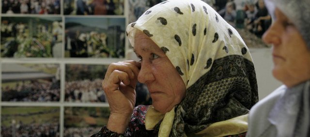 A Bosnian Muslim woman, survivor of genocide operations in Srebrenica in 1995, watches the live broadcast of the Hague Tribunal's trial Friday for Radovan Karadzic in Sarajevo. Bosnian Serb wartime leader Radovan Karadzic made a second appearance before a war crimes tribunal in the Hague.