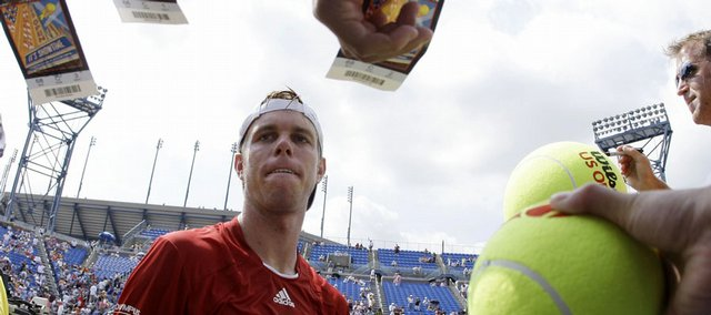San Querrey signs autographs after defeating Ivo Karlovic in the U.S. Open. Querrey won his match, 7-6 (5), 7-6 (5), 6-2, on Saturday in New York.