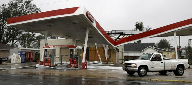 A driver surveys the damage to a Conoco gas station Monday after Hurricane Gustav stormed through Houma, La.