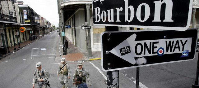 Members of the National Guard patrol along Bourbon Street on Sunday in New Orleans. Hurricane Gustav is expected to hit the area today.