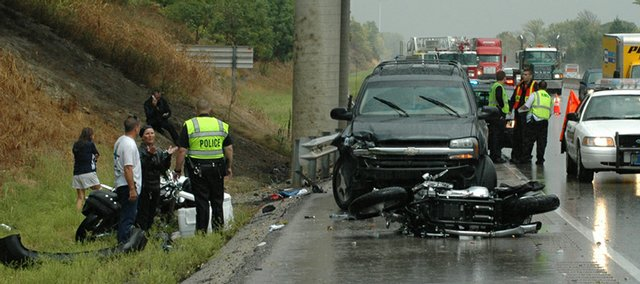 Emergency responders survey the scene at a fatal accident on westbound Interstate 70 Tuesday.