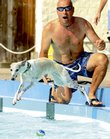 Chris Breit and his Whippet, Poppy, play at the Lawrence Outdoor Aquatic Center in Sept. 2008. Several hundred dog owners brought their pets to the pool for the Pooch Plunge, the final event of the summer.