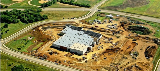 This aerial photograph shows recent progress on the Wal-Mart that's being built at the northwest corner of Sixth Street and Wakarusa Drive. The view is looking northeast toward Free State High School.