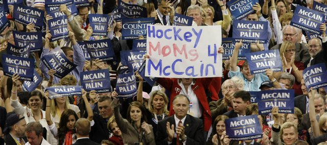 Republican delegates hold their signs in support of the party's candidates Wednesday at the Republican National Convention in St. Paul, Minn. In his speech tonight, McCain is expected to capitalize on the maverick theme, touting his running mate Alaska Gov. Sarah Palin as an upstart reformer like himself.