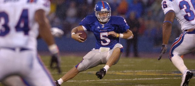 KU quarterback Todd Reesing scrambles to find some open space Saturday, Sept. 6, 2008 during the Jayhawks' 29-0 victory at Memorial Stadium.
