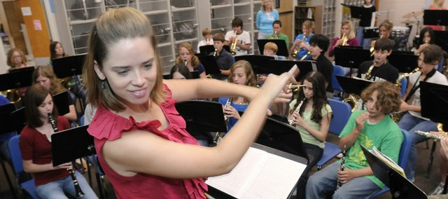 Lauren Gaugert, 27, band director at West Junior High School, conducts one of her morning classes. Gaugert loves helping kids move past the awkwardness of junior high, a phase she struggled with herself.
