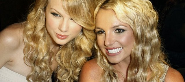 Taylor Swift, left, poses with Britney Spears at the 2008 MTV Video Music Awards, held at Paramount Pictures Studio Lot on Sunday in Los Angeles.