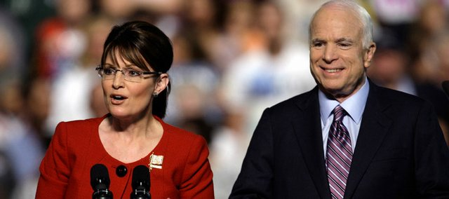 Republican presidential nominee Sen. John McCain, R-Ariz., right, and his vice presidential running mate, Alaska Gov. Sarah Palin, address the crowd at a campaign rally Tuesday at Franklin & Marshall College in Lancaster, Pa.