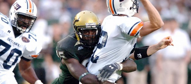 USF defensive end George Selvie hits UT Martin quarterback Cade Thompson in this Aug. 30 file photo in Tampa, Fla. Selvie, who led the country in tackles