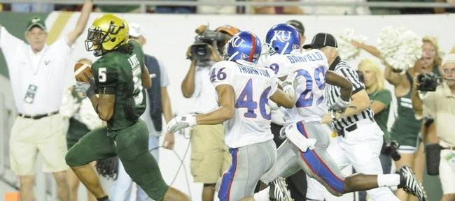 South Florida receiver A.J. Love leaves Kansas defenders Justin Thornton and Isiah Barfield in the dust as he heads in for a touchdown during the fourth quarter Friday, Sept. 12, 2008 at Ray