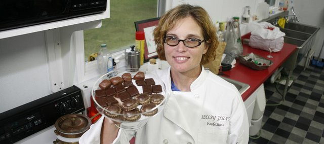 Jean Younger, owner of Sleepy Jean's Confections, grinds her own beans and makes chocolate from scratch in her rural Douglas County home. Her chocolates can be bought at various stores in Lawrence and on her Web site.