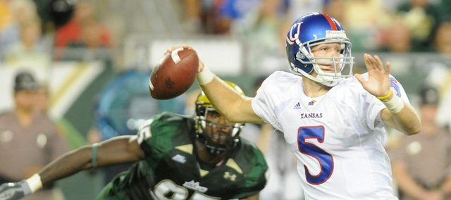Kansas quarterback Todd Reesing pulls back to fire as South Florida defensive end George Selvie lingers in the background during the first half Friday, Sept. 12, 2008 at Raymond James Stadium in Tampa.