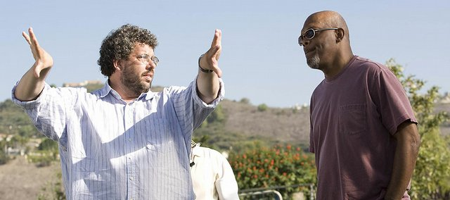 From left, director Neil LaBute confers with actor Samuel L. Jackson.