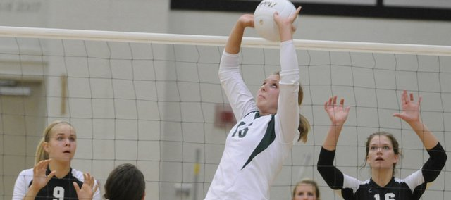 Free State senior Ali Jacobsen sets up a teammate in the Firebirds' first match against Blue Valley Northwest Thursday, Sept. 18, 2008.