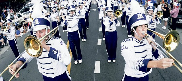 Trombone players from the Baldwin High School Marching Band perform during the KU Band Day Parade in downtown Lawrence, Kan. on Saturday, Sept. 20, 2008.