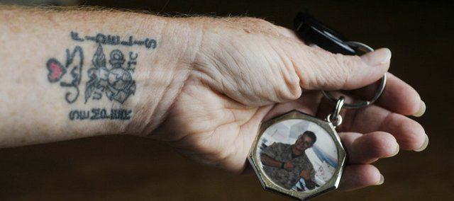 Candy Wasser, Ottawa, holds a key ring with a photo of her son Chris, who was killed in Iraq. Recently she had a tattoo put on her wrist with her son's name along with the U.S Marine symbol.