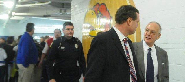Kansas coach Bill Self walks with former KU coach Larry Brown, right, after Kansas' victory over Colorado in this file photo from Feb. 16. Brown was in town for the 20-year anniversary of the 1988 national title team. He'll be back this week for a Bert Nash fundraiser.