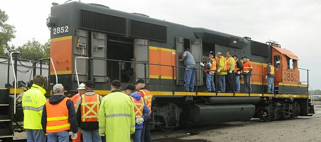 Law enforcement agencies worked with officials from Burlington Northern Santa Fe Railway on Wednesday in the rail yards in east Lawrence. The training exercise was to help officials investigate accidents involving trains.
