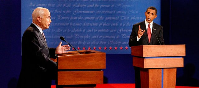 Republican presidential Nominee Sen. John McCain, R-Ariz., left, and Democratic nominee Sen. Barack Obama, D-Ill., meet for their first debate at the University of Mississippi in Oxford. Foreign policy was the main focus of the first presidential debate.