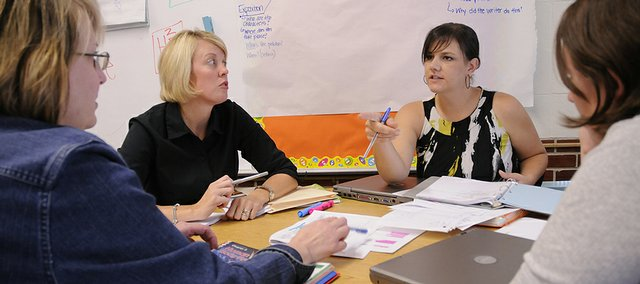 Learning Coach Kristen Ryan, second from left, works on science and health curriculum Sept. 24 with Hillcrest fifth-grade teacher Jennifer Cochrane, second from right. At far left is learning coach Carol Laskowski, and at far right is fifth-grade ESL teacher Leah Weseman. The Lawrence school district launched an initiative this year to provide teachers with 16 learning coaches for assistance and professional development.