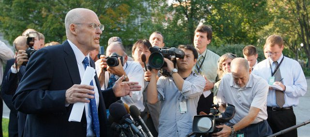 Treasury Secretary Henry Paulson briefs reporters Monday at the White House in Washington after his meeting with President Bush regarding the defeated $700 billion bailout bill.