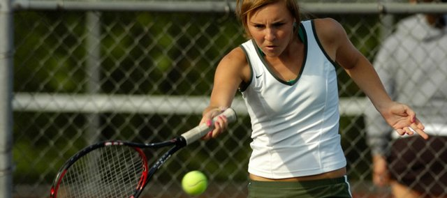 Free State High junior Mackenzie Lown returns a volley Monday during the Firebirds' match against Lawrence High at the Lawrence Tennis Center. This is the first year LHS has won the city dual meet since Free State opened in 1997.