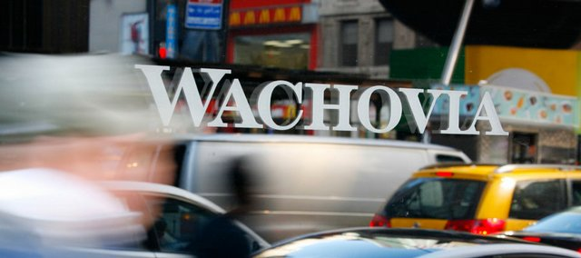 A person is reflected in the window of a Wachovia Corp. branch office Monday in New York. Citigroup Inc. will acquire the banking operations of Wachovia Corp. in a deal facilitated by the Federal Deposit Insurance Corp.