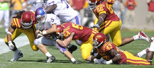 Kansas quarterback Todd Reesing is dragged down by the Iowa State defense late in the second quarter Saturday, Oct. 4, 2008 at Jack Trice Stadium in Ames.