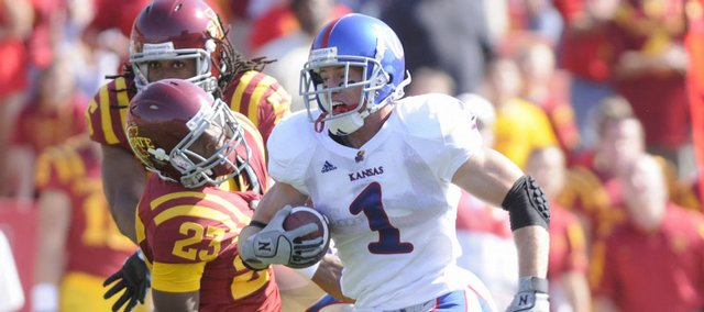 Kansas running back Jake Sharp tears past Iowa State defensive back Leonard Johnson during the third quarter Saturday, Oct. 4, 2008 at Jack Trice Stadium in Ames. Sharp added two touchdowns to the Jayhawks' comeback victory.