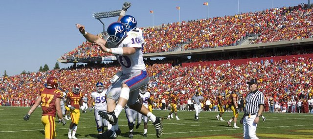 Kansas University receiver Kerry Meier (10) gives a celebratory bump to fellow receiver Johnathan Wilson following Meier's second touchdown. The Jayhawks rallied from a 20-0 deficit to beat Iowa State, 35-33, on Saturday in Ames, Iowa.