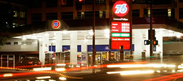 "A long exposure blurs the lights of cars passing a Conoco Phillps 76 gas station Thursday in Seattle. ""We've been through almost eight years of continuously rising gasoline prices,"" said AAA spokesman Geoff Sundstrom. ""Any notion that this is a temporary thing has pretty well been erased as a point of view among most consumers."""