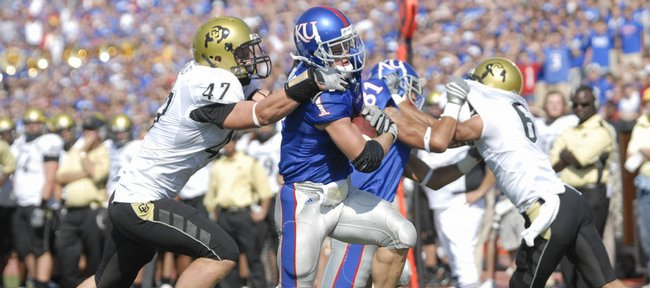 Kansas' Jake Sharp drags Colorado's Shaun Mohler into the end zone on Saturday, Oct. 11, 2008 at Memorial Stadium.  Sharp scored three touchdowns in the game.