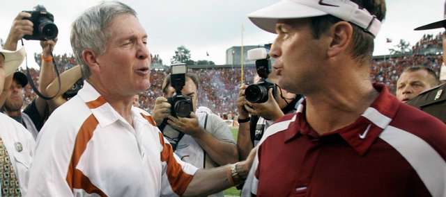 Texas coach Mack Brown, left, congratulates Oklahoma coach Bob Stoops in this Oct. 6, 2007, file photo after OU beat UT, 	28-21, last season in Dallas.