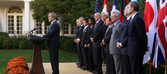 President Bush makes a statement in the Rose Garden of the White House after meeting with G7 finance ministers about the financial crisis Saturday in Washington. Pictured from left to right: Italy's central bank governor Mario Draghi; IMF Managing Director Dominique Strauss-Kahn; Eurogroup's Chairman Jean-Claude Juncker; Japan's Finance Minister Shoichi Nakagawa; U.S. Secretary of State Condoleezza Rice, U.S. Treasury Secretary Henry Paulson; France's finance minister Christine Lagarde; Canada's finance minister James M. Flaherty; Britain's Chancellor of the Exchequer Alastair Darling, Italy's finance minister Giulio Tremonti; Germany's Minister of Finance Peer Steinbrueck; and World Bank President Robert Zoellick.