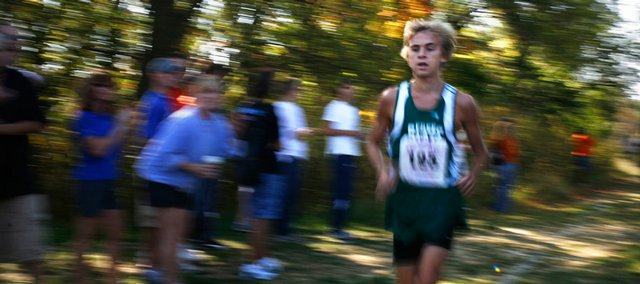 Free State Sophomore Logan Sloan puts some distance between him and his opponents during the Haskell Invitational. Sloan won the varsity boys race Saturday at Haskell Indian Nations University.
