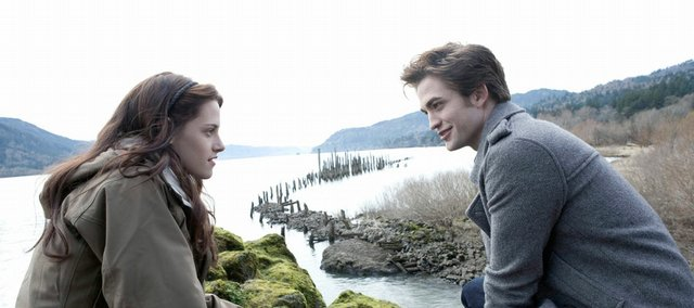 "In this file image released by Summit Entertainment, Kristen Stewart as ""Bella,"" left, and Robert Pattinson as ""Edward"" are shown in a scene from ""Twilight."" Dead-but-still-talking characters are all over popular culture these days."
