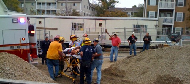 Lawrence Douglas County Fire and Medical crews evacuate an injured construction worker from the site of the new Oread Inn. Early reports indicate the person fell from a free-standing pillar in the center of the site. He was taken by ambulance to a waiting helicopter and then transferred to a Kansas City-area hospital.